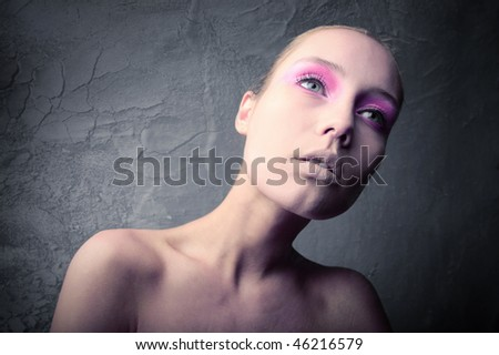 Portrait of a beautiful woman with elegant makeup - stock photo