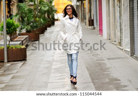 Portrait of a beautiful woman with eyes glasses walking in urban background