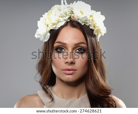 Portrait of a beautiful woman with flowers in her hair. Fashion - stock photo