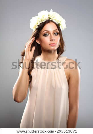 Portrait of a beautiful woman with flowers in her hair. Fashion. - stock photo