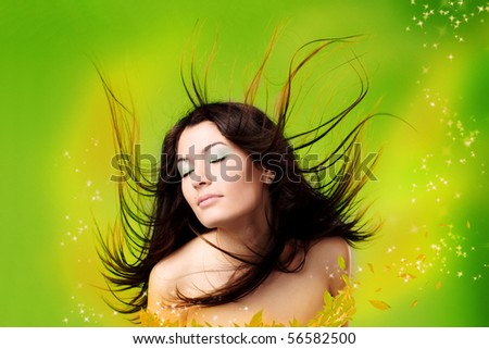 portrait of a beautiful woman with flying hair - stock photo