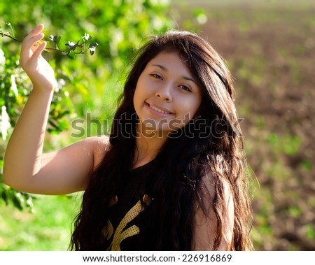 portrait of a beautiful woman with green leaves