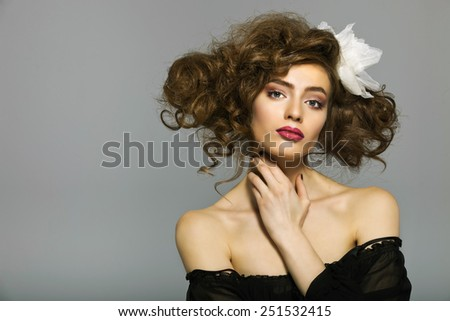 Portrait of a beautiful woman with healthy long brown hair and fresh makeup. Wavy Hair. Hairstyle. Not isolated on grey background - stock photo