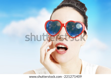 Portrait of a beautiful woman with heart shaped glasses, on white background - stock photo