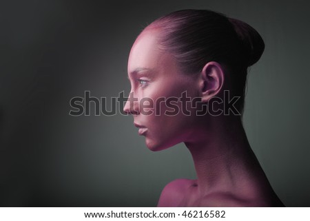Portrait of a beautiful woman with her face colored in red - stock photo