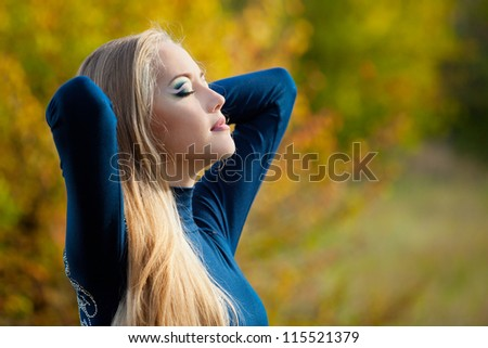 Portrait of a beautiful woman with long hair in the autumn day. Soft Focus - stock photo