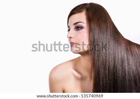 Portrait of a beautiful woman, with long shinning hair