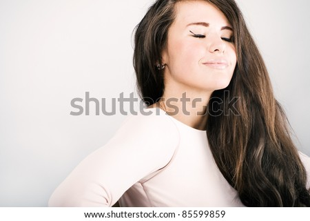Portrait of a beautiful woman with long wavy hair. - stock photo
