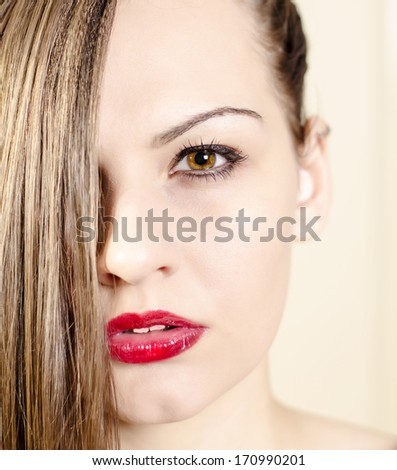 Portrait of a beautiful woman with make up, looking straight. Beauty fashion concept.