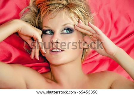 portrait of a beautiful woman with makeup close - stock photo