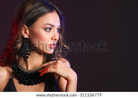 Portrait of a beautiful woman with necklace - stock photo