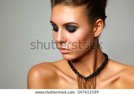 Portrait of a beautiful woman with necklace, isolated on white background