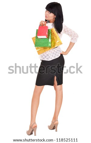 portrait of a beautiful woman with packages on a white - stock photo