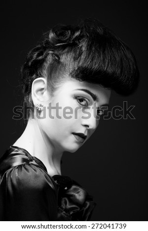 Portrait of a beautiful woman with stylish hairstyle and makeup