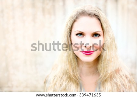 Portrait of a beautiful woman with wavy blonde hair - stock photo