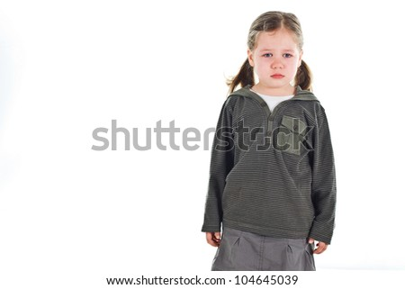 Portrait of a beautiful 3-year-old girl standing very sad - isolated on white - stock photo