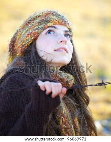 Portrait of a beautiful 20 year old woman outdoor in autumn. - stock photo
