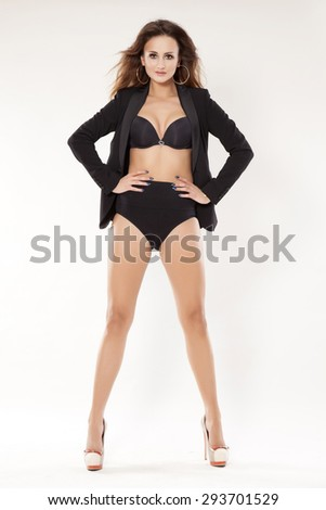 portrait of a beautiful young adult sensuality attractive pretty brunette woman in black lingerie and jacket isolated on white background - stock photo