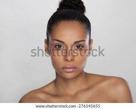 Portrait of a beautiful young African woman smiling, Beauty concept  - stock photo
