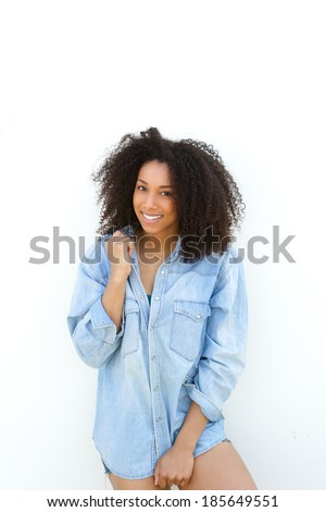 Portrait of a beautiful young african woman smiling outdoors during summer - stock photo