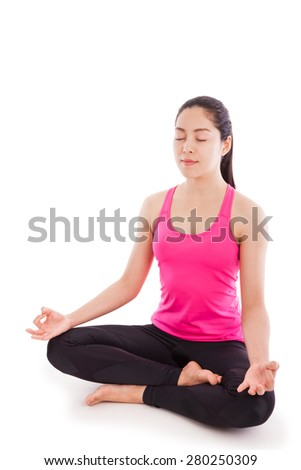 Portrait of a beautiful young asian (thai) woman practicing yoga, sitting in a lotus position isolated on white background. Some space for input text message. Studio shot. - stock photo