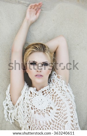Portrait of a beautiful young attractive sexy and sensuality pretty blonde woman in sand background - stock photo