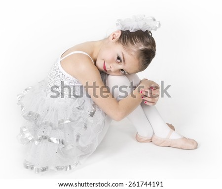 Portrait of a beautiful young ballerina - stock photo