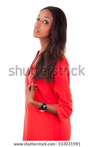 Portrait of a beautiful young black woman in red dress, isolated on white background - stock photo