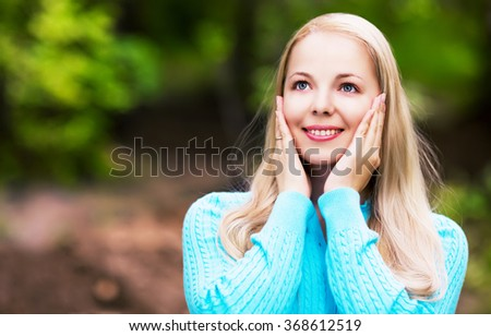portrait of a beautiful young blind woman outdoor in the park - stock photo