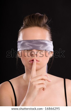 Portrait of a beautiful young blindfold woman - stock photo