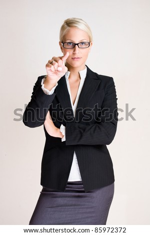 Portrait of a beautiful young blond business pointing at you. - stock photo