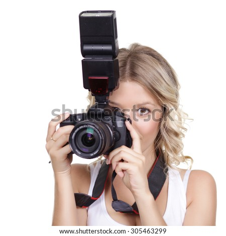 Portrait of a beautiful young blond female with camera, isolated on white background