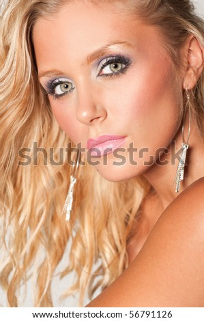 Portrait of a beautiful young blond woman's face with gorgeous eyes.