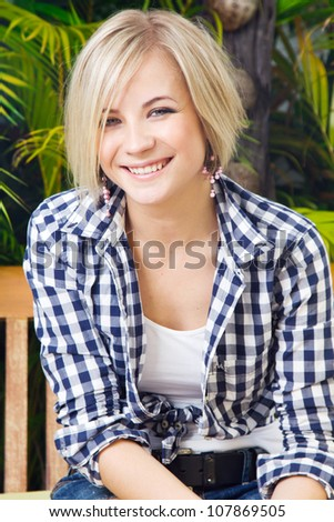 Portrait of a beautiful young blonde woman - stock photo