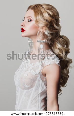 portrait of a beautiful young blonde woman in a white dress with red lips - stock photo