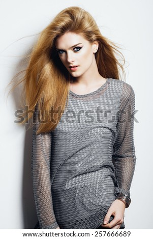 Portrait of a beautiful young blonde woman in studio on white background, concept of beauty and health - stock photo