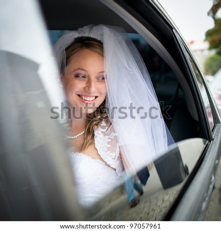 Portrait of a beautiful young bride waiting in the car on her way to the wedding ceremony