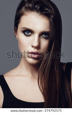 Portrait of a beautiful young brunette girl, beauty concept