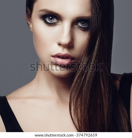 Portrait of a beautiful young brunette girl, beauty concept - stock photo