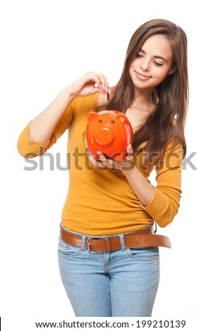 Portrait of a beautiful young brunette posing with colorful piggy bank. - stock photo