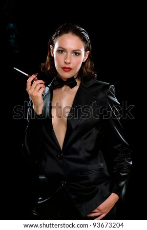 Portrait of a beautiful young brunette with cigarette. Isolated