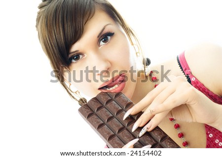 portrait of a beautiful young brunette woman eating a bar of chocolate - stock photo