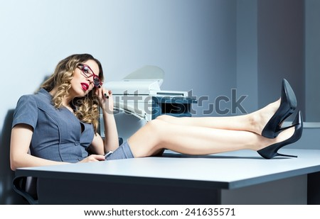 Portrait of a beautiful young business woman in the office - stock photo