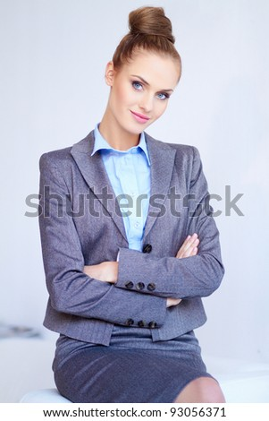 Portrait of a beautiful young business woman on white - stock photo