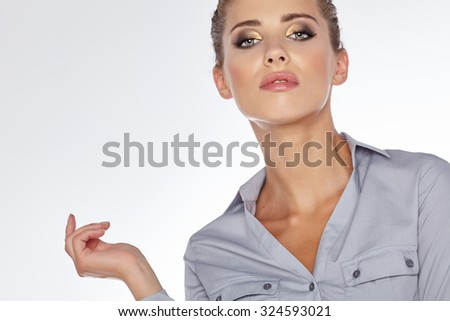 Portrait of a beautiful young business woman standing against white background - stock photo