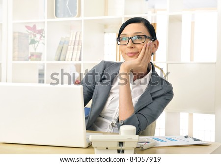 Portrait of a beautiful young businesswoman thinking. Office background. - stock photo