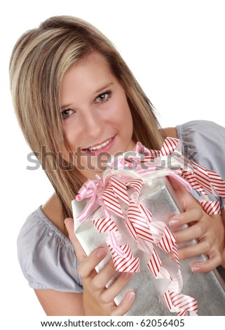 portrait of a beautiful young caucasian blond woman holding a wrapped gift isolated on white background