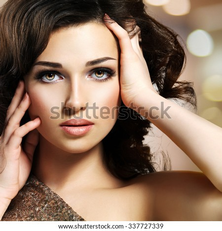 Portrait of a Beautiful young caucasian sexy woman. Pretty fashion model with dark brown eye makeup - stock photo