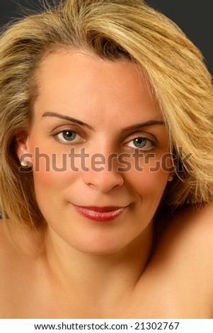 Portrait of a beautiful young Caucasian woman looking at the camera - stock photo
