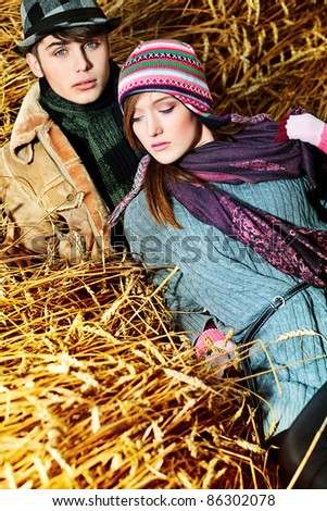 Portrait of a beautiful young couple in warm clothes outdoor.